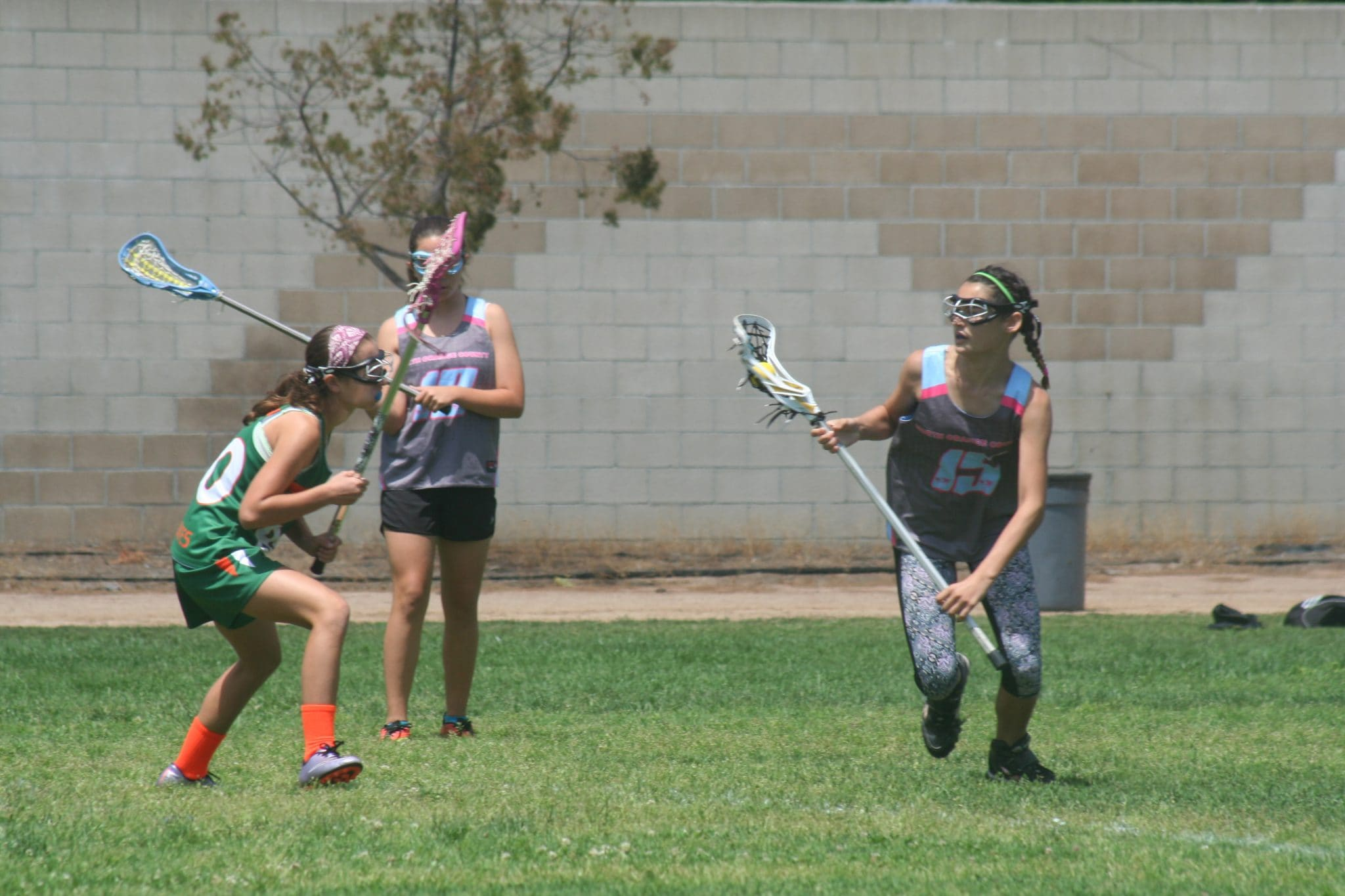 girls playing lacrosse may ask about the best sports drinks