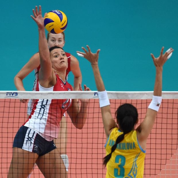 Volleyball Knee Injuries: Tori Dixon of USA Volleyball hits at the net in a match
