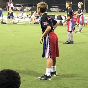specialize: flag football player waits for the play to begin