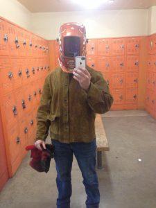 Newborn: a now grown patient poses in his welding uniform