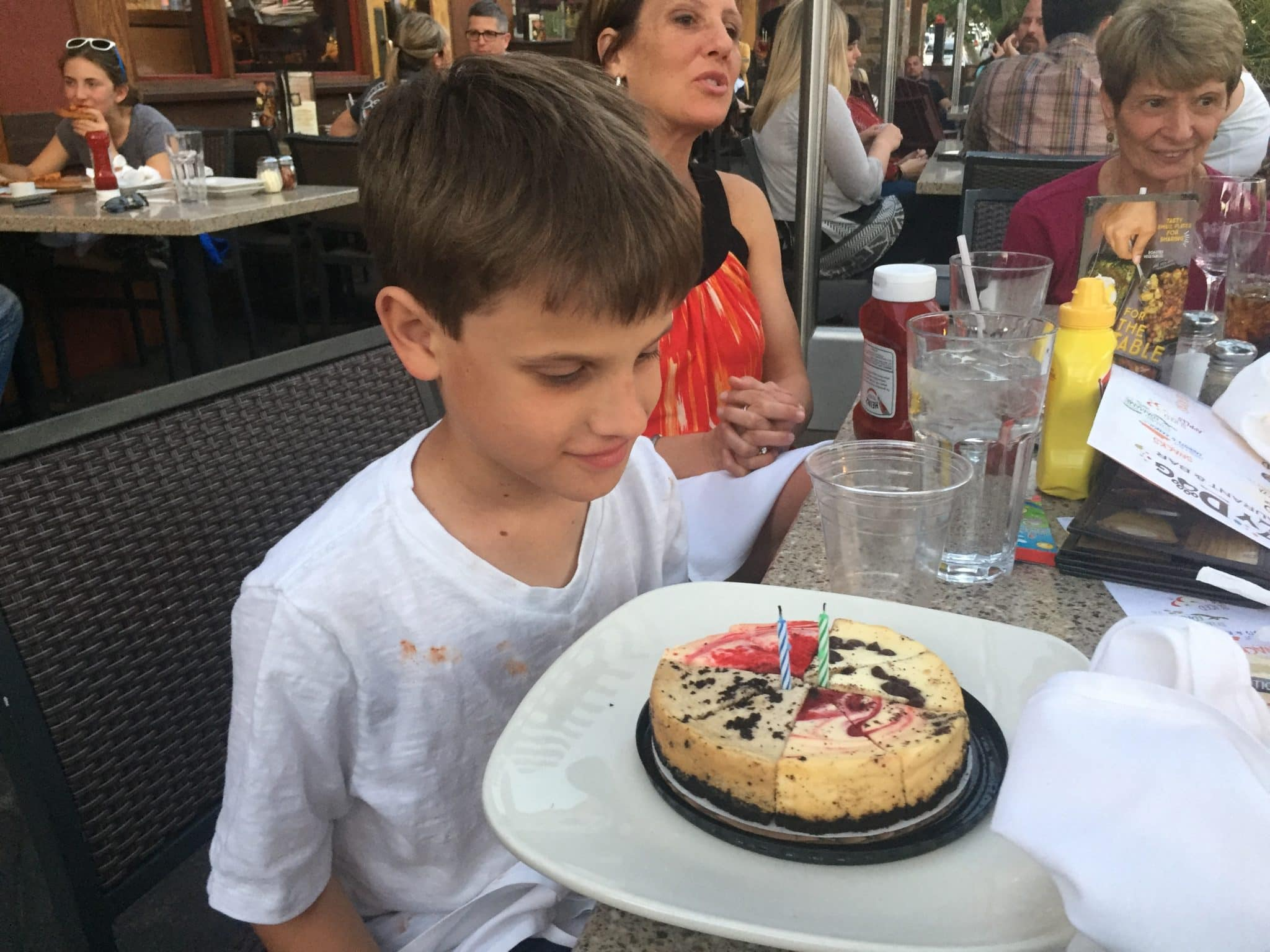 Sports Schedules: Picture of Young Boy looking at his birthday cake