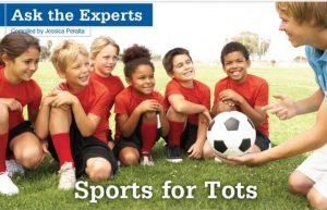 Starting sports: picture of kids sitting as an adult shows them a soccer ball